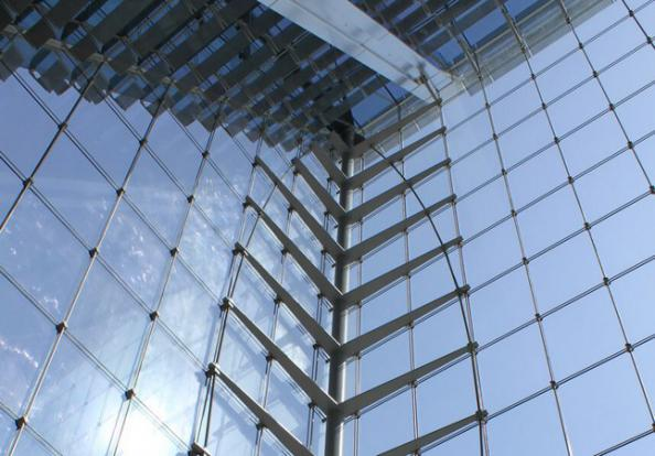Are curved glass facade panels more expensive than regular ones?
